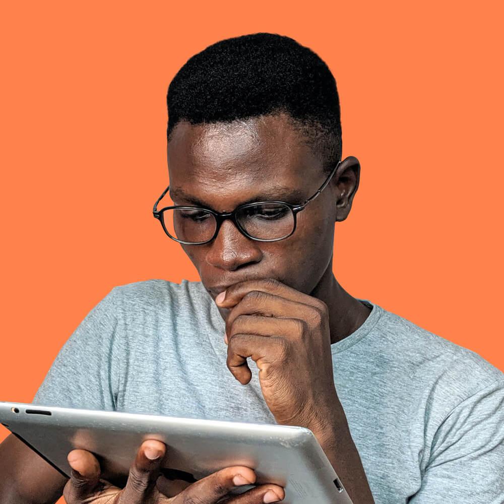 Man watching at iPad